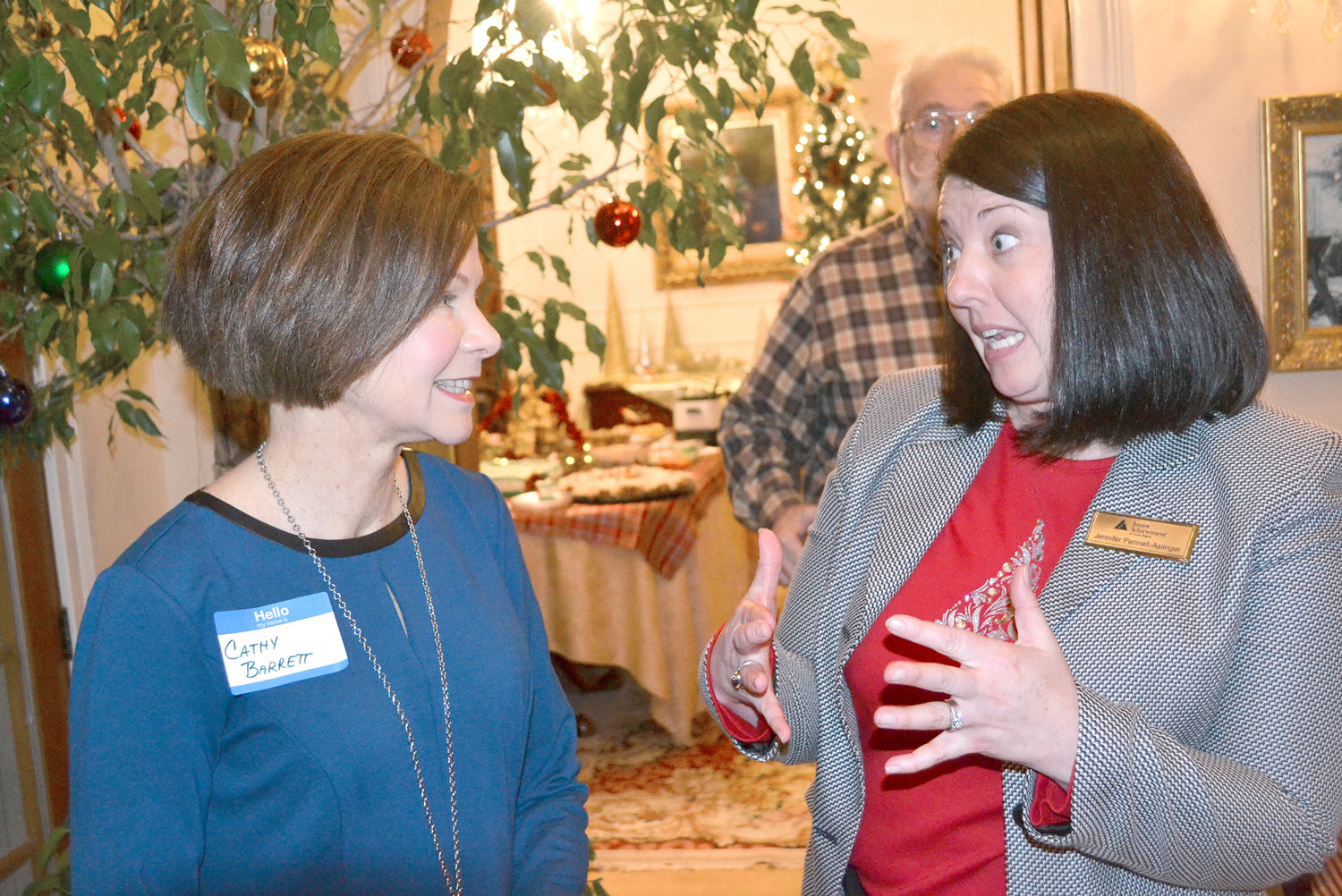 JENNIFER PENNELL-ASLINGER, new Junior Achievement president, speaks with Cathy Barrett, who served in that position in the late 1980s and early 1990s.