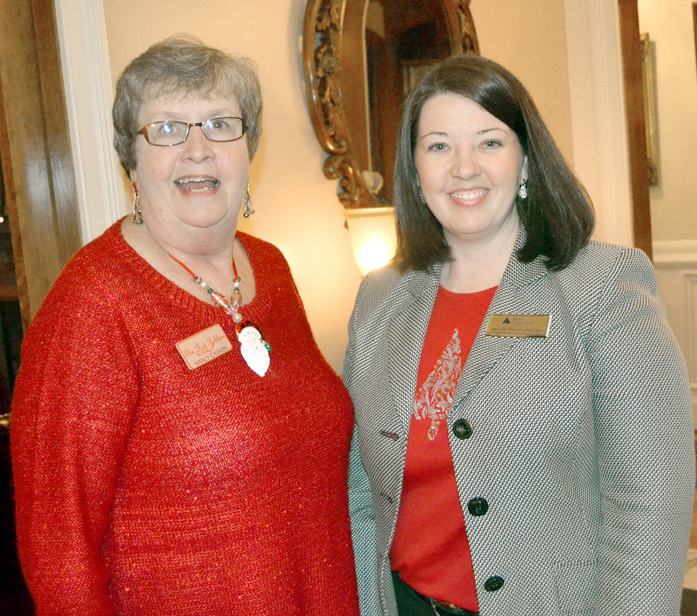 BOARD MEMBER NANCY CASSON, left, visited with new Junior Achievement of the Ocoee Region President Jennifer Pennell-Aslinger at the reception held for the new president.