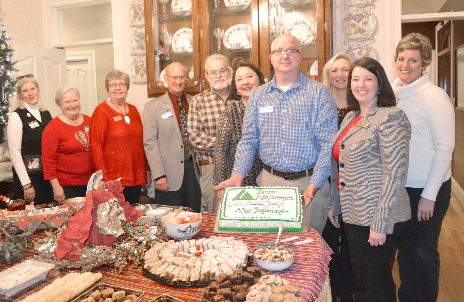 BOARD MEMBERS recently held a reception for new Junior Achievement of the Ocoee Region President Jennifer Pennell-Aslinger at the home of David and Margaret Schenck. From left are Kellye Hicks, Bobbie Edson-Jones, Nancy Casson, Ken Jones, David Schenck, Margaret Schenck, Josh Aslinger, Melissa Gunnell, Jennifer Pennell-Aslinger and Rachel Brannen.