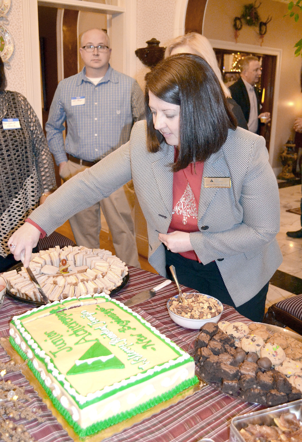 A SPECIAL WELCOMING CAKE was prepared for the new president of Junior Achievement of the Ocoee Region. Jennifer Pennell-Aslinger became JA president in early October.