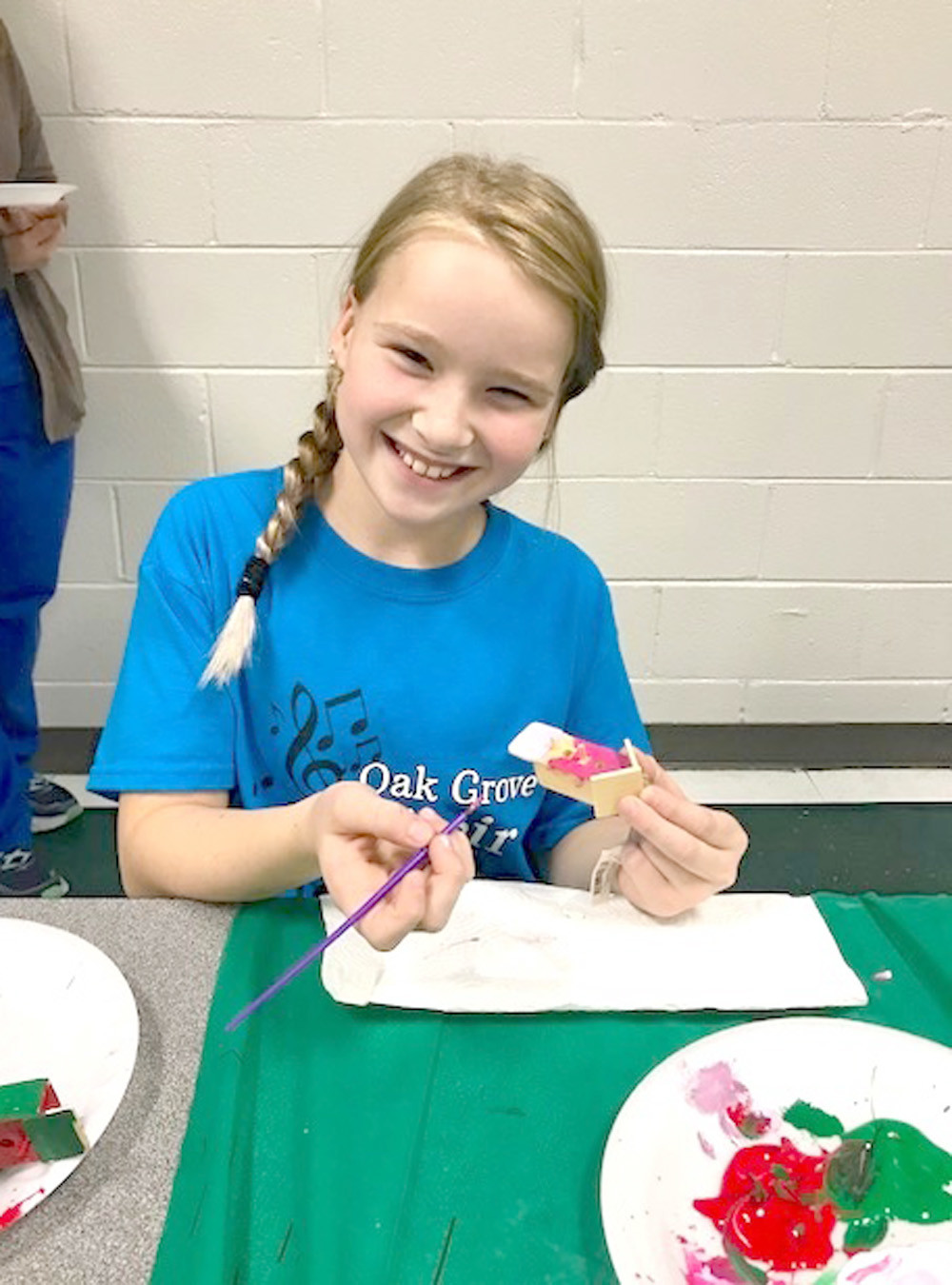 "TRINITY LUNSFORD works on a colorful Christmas ornament during Oak Grove Elementary's ""Old Fashioned Christmas at the Grove."""