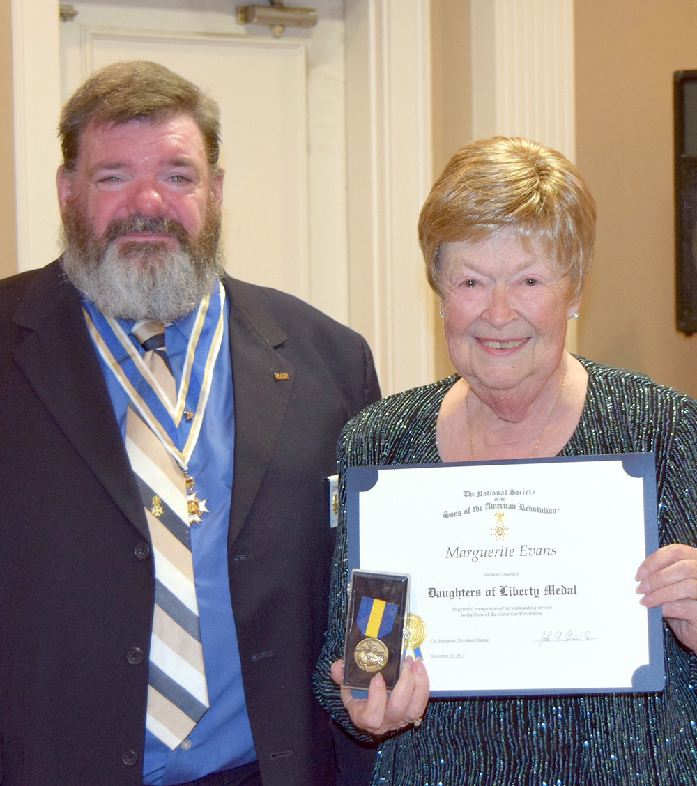 MAGGIE EVANS receives the Daughters of Liberty Medal from John Clines.