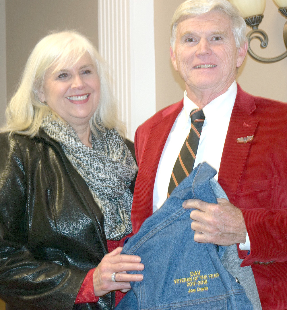 JOE DAVIS and wife, Tanna, hold the Disabled American Veteran of the Year jacket.
