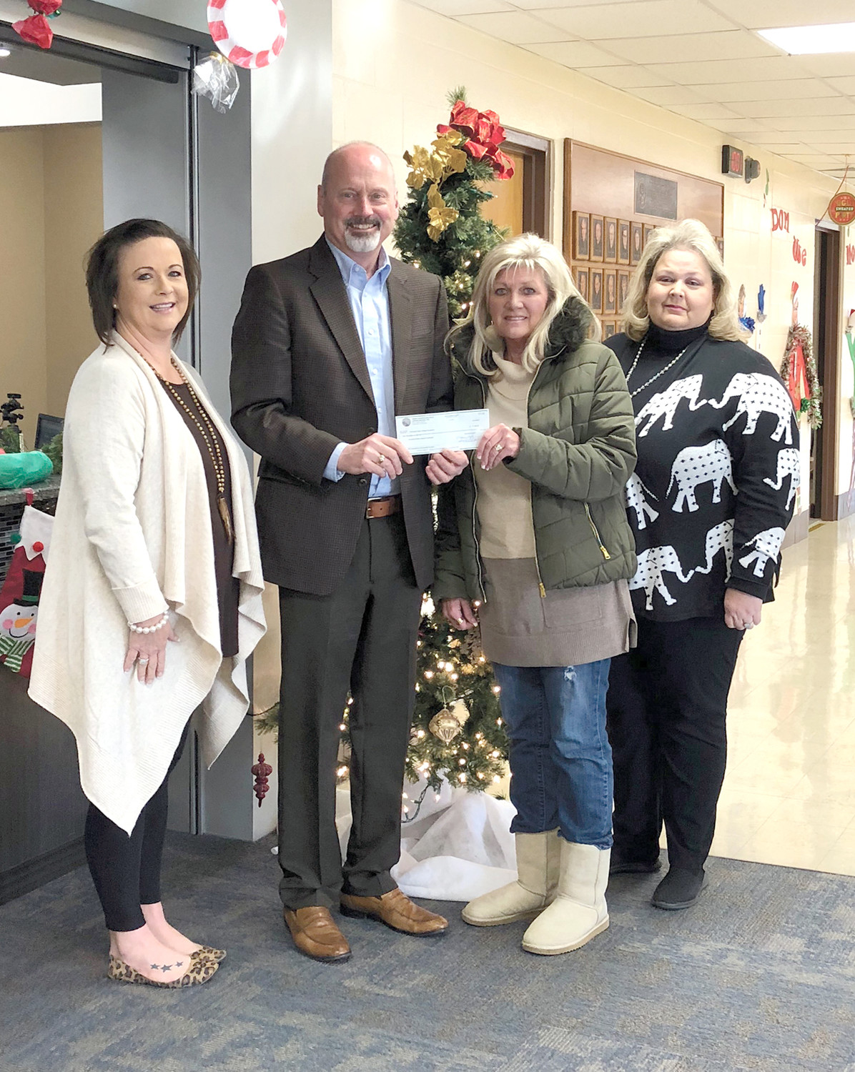 The River Counties Association of Realtors recently presented its annual gift of $1,000 to the Cleveland State Foundation to support student scholarships. The purpose of RCAR is to create a professional environment for its members, enabling them to provide ethical, high-quality real estate services to their communities. From left are Tara Hampton, association executive; Dr. Bill Seymour, CSCC president; Marcia Botts, 2017 MLS president; and Cathy McCracken, 2017 MLS treasurer.