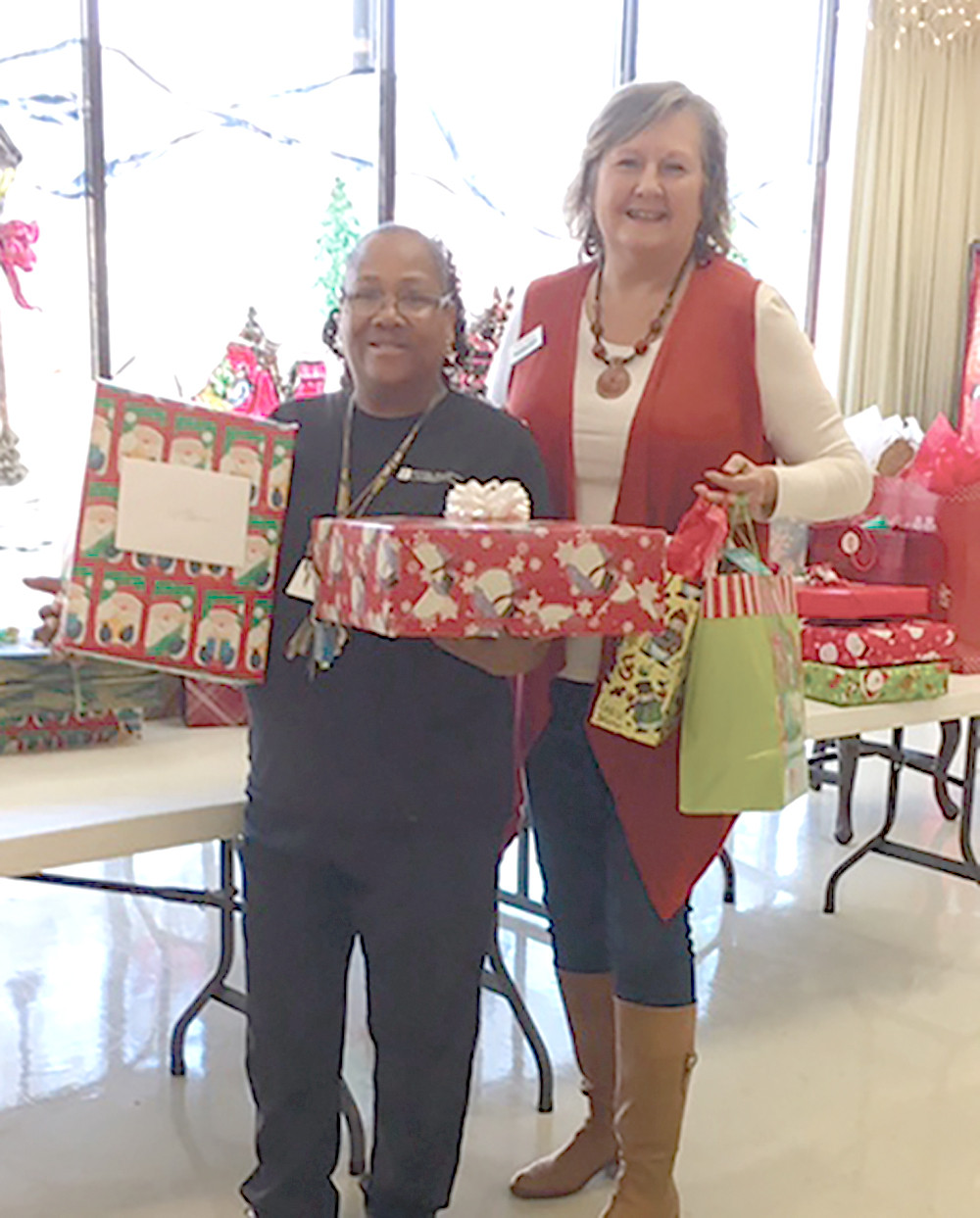 The Staff Senate at CSCC provided Christmas gifts to the residents at Bradley Healthcare and Rehabilitation. From left are Donna Martin, Bradley Healthcare and Rehab activities assistant, with CSCC Staff Senate Secretary Cindy Dawson.