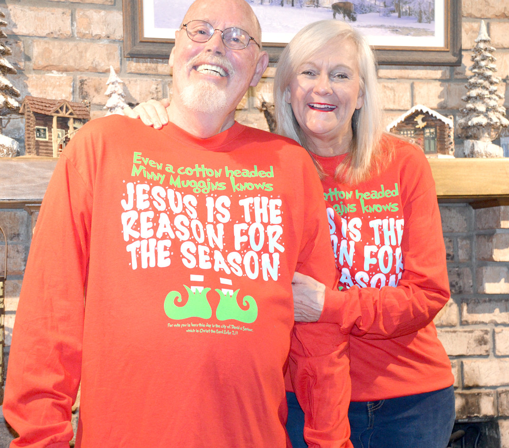 "DOUG AND ANNIE Baynes pose in their ""Elf""-themed shirts as the holidays begin."