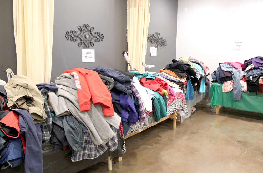 COATS and other clothing, donated by Chattanooga Goodwill Industries, line tables in a room at Franklin Academy during the cosmetology school's event for the homeless and needy.