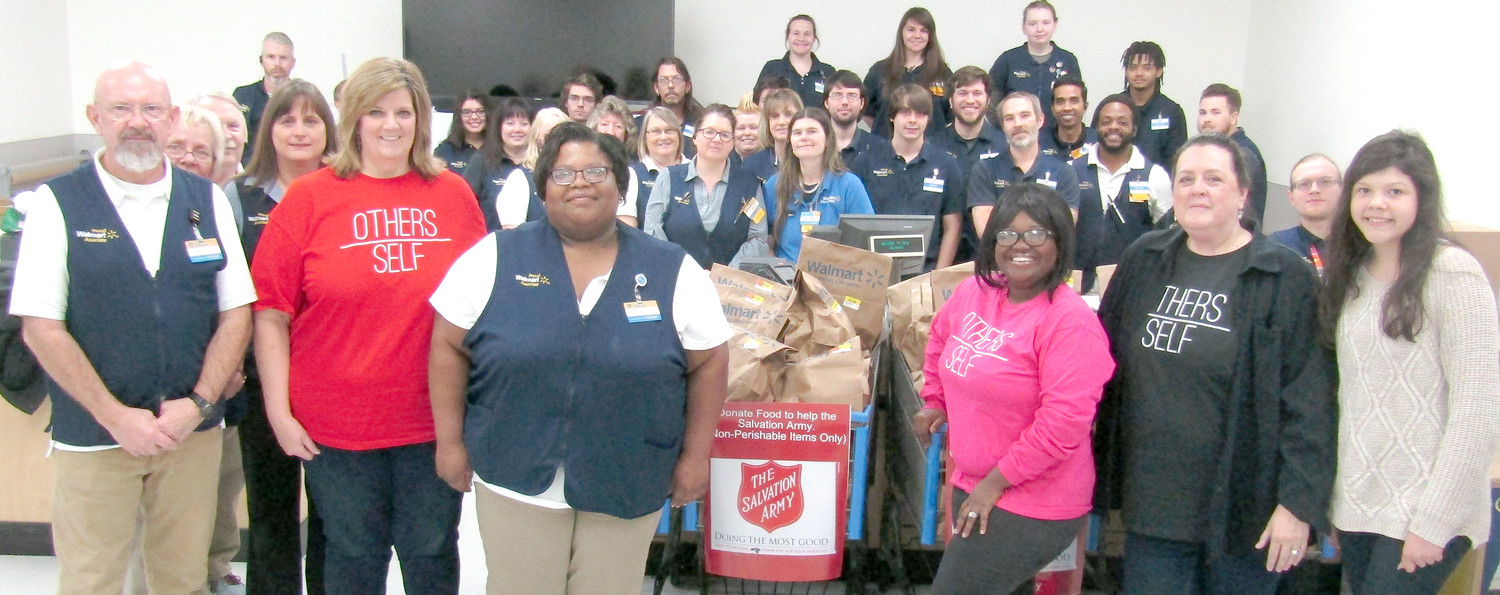 ASSOCIATES at Walmart North presented 105 bags of non-perishable foods to the Salvation Army to help refill their food pantry.
