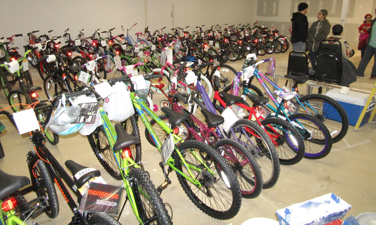 ALMOST 100 brand new bicycles stand ready to make some children's Christmases brighter as they are prepared to be distributed by the Salvation Army.
