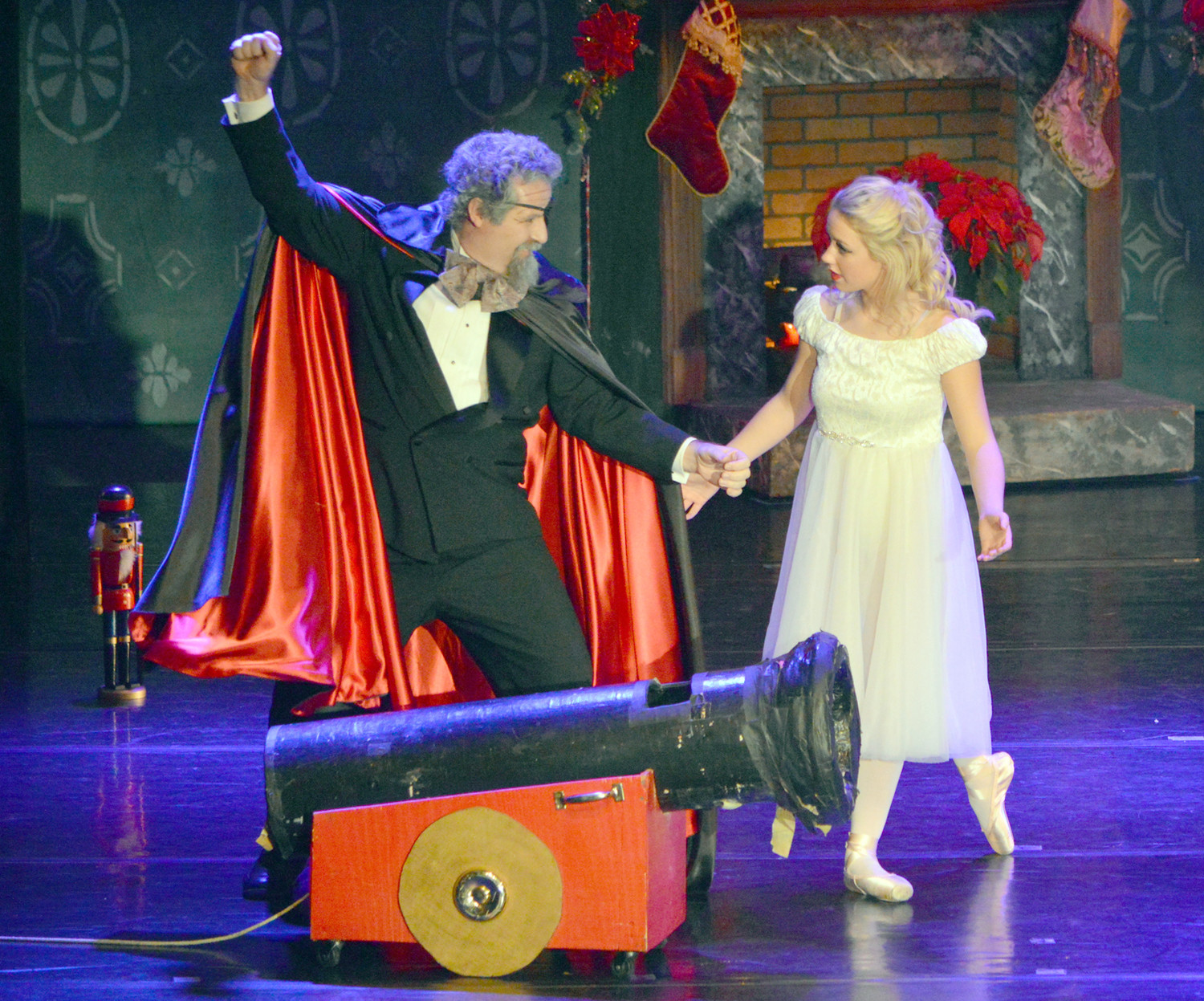 HERR DROSSELMEYER (Don Markham) prepares Clara (Maddie Robinson) for a battle with the Mouse Queen and her army of mice.