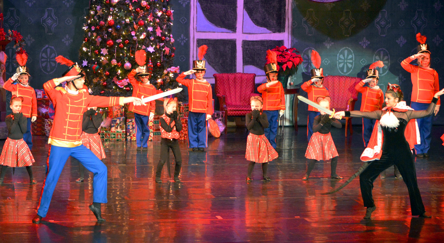 NUTCRACKER PRINCE (Gabriel Shoop) and brave toy soldiers battle the mouse queen (Lindsay Markham) and her army.