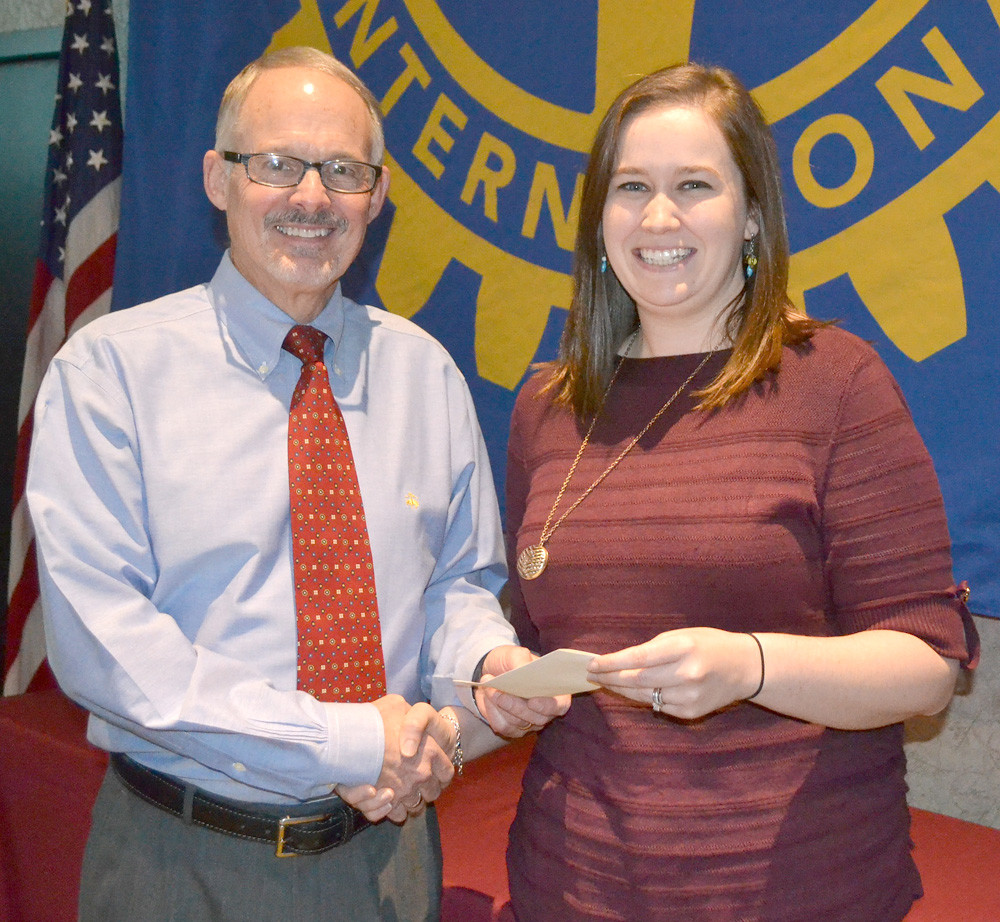 DR. PAUL MCCORD, left, presents a grant from the Rotary Club of Cleveland to Jessica Derrick of United Way of the Ocoee Region's Imagination Library.