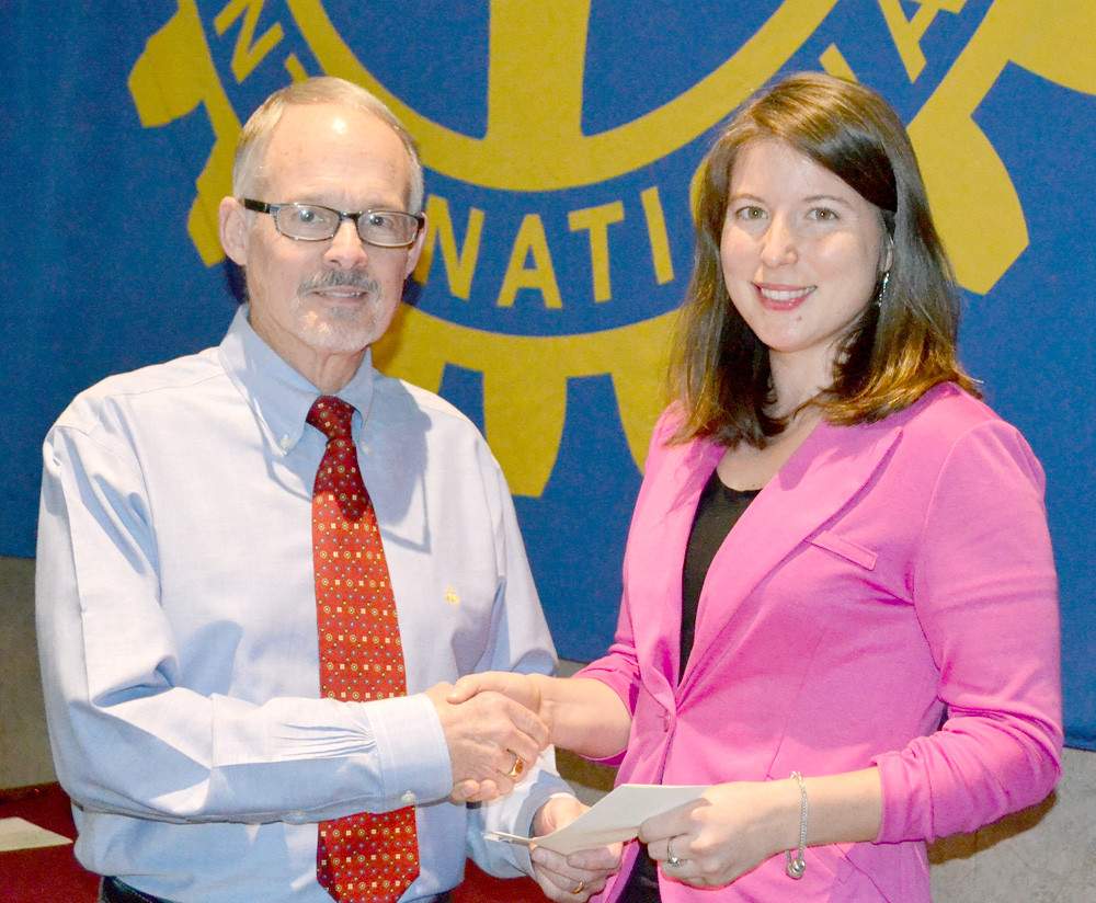 DR. PAUL MCCORD, left, presents a grant from the Rotary Club of Cleveland to Delaney Walker of the New Hope Pregnancy Center.