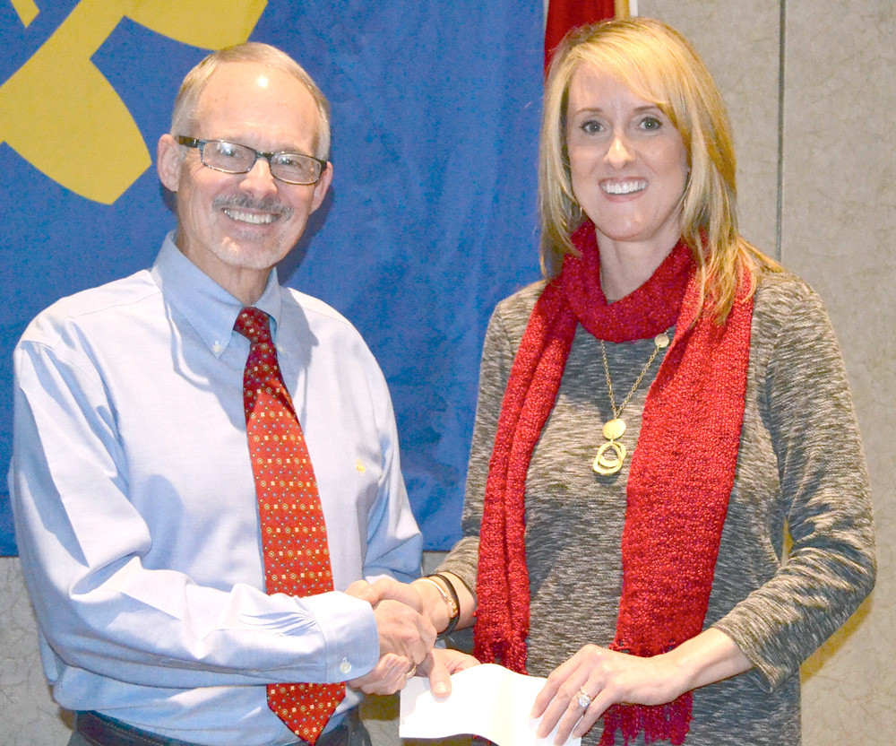 DR. PAUL MCCORD, left, presents a grant from the Rotary Club of Cleveland to Tammy Johnson of Habitat for Humanity of Cleveland.