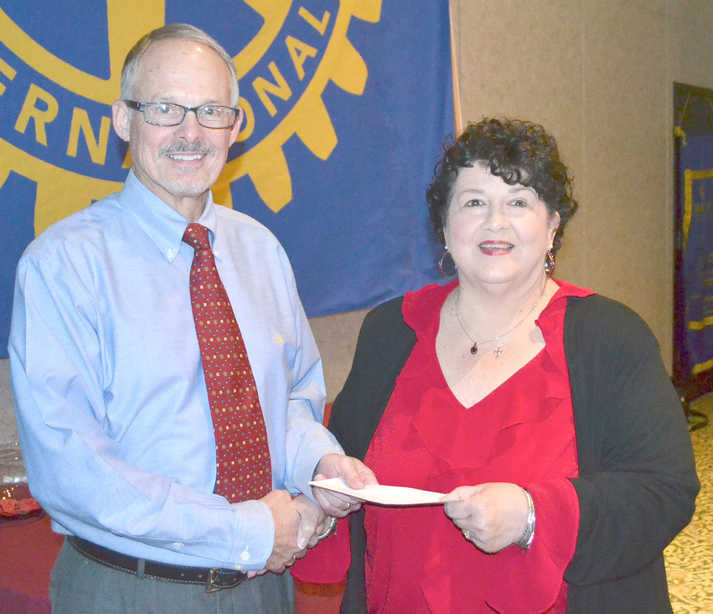 DR. PAUL MCCORD, left, presents a grant from the Rotary Club of Cleveland to Suzanne Wood of Cleveland State Community College.