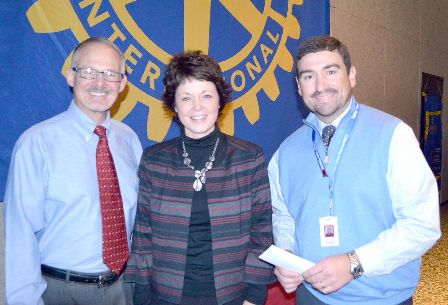 DR. PAUL MCCORD, left, presents a grant from the Rotary Club of Cleveland to Stephanie Jones, center, and Corey Limburg of Valley View Elementary School.