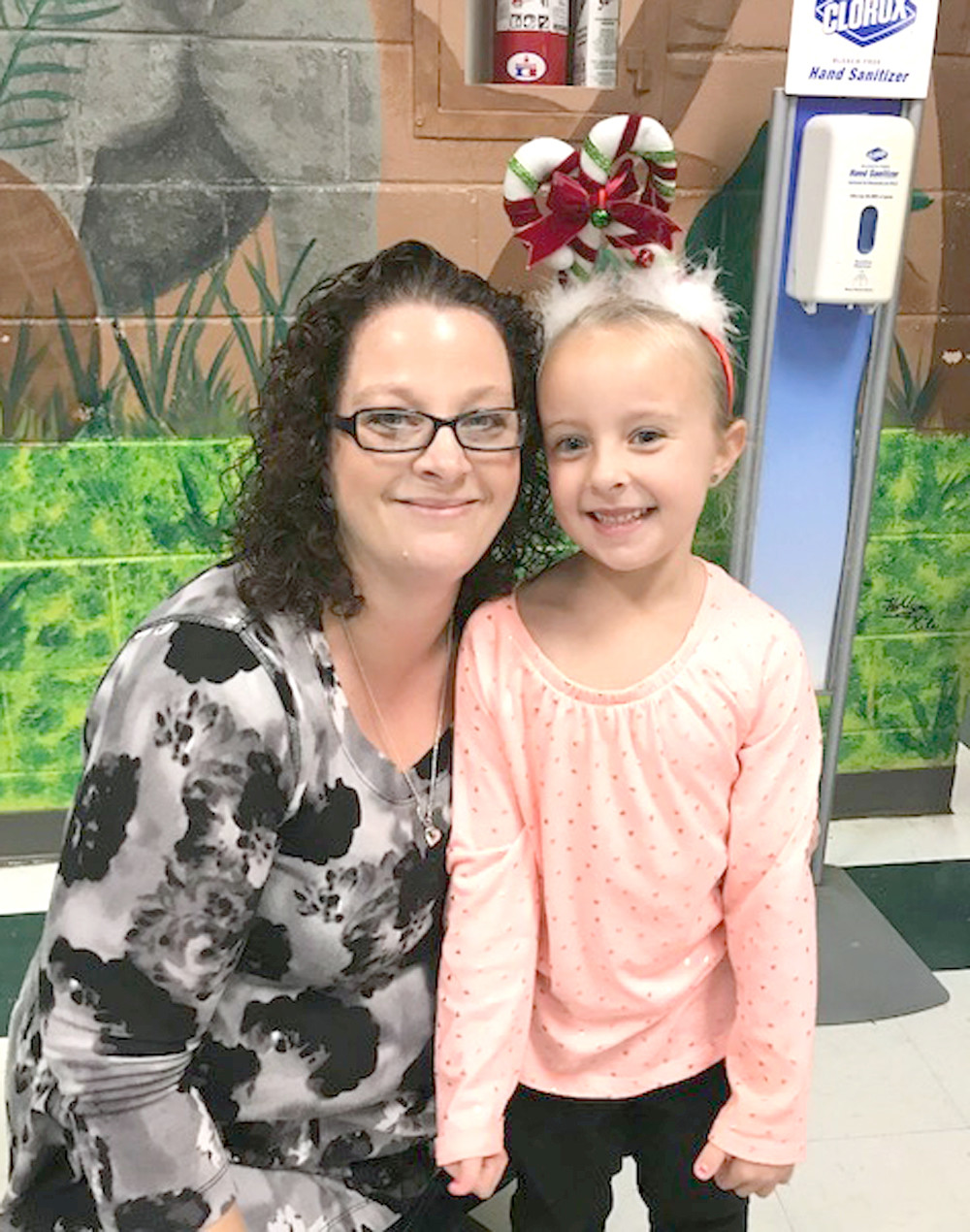 SONJA AND TAYLOR DUDASH spend some quality time together during Old Fashioned Christmas at the Grove at Oak Grove Elementary.