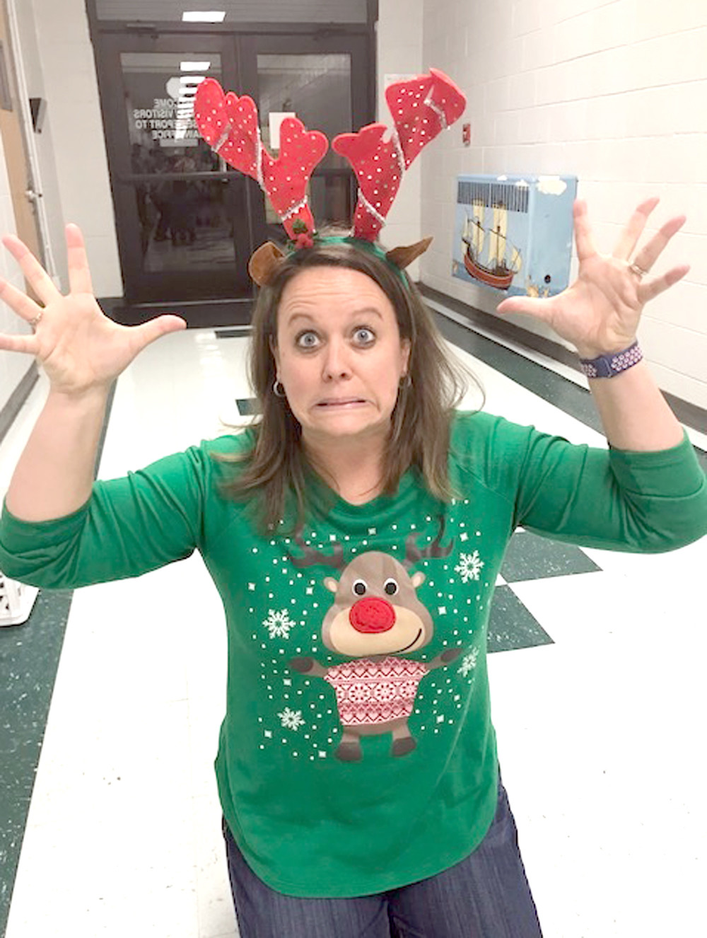 JENNIFER DAVIS, a third-grade teacher, goes all in on the festive fun during a Christmas event at Oak Grove Elementary.