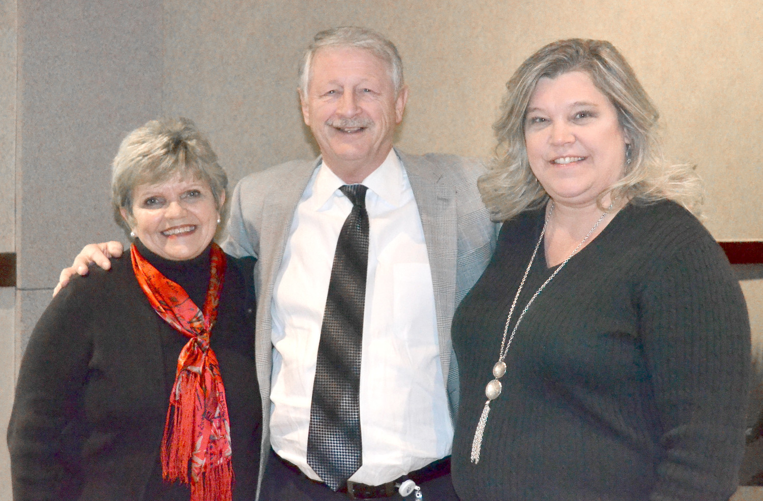 RETIRING 911 DIRECTOR Joe Wilson is flanked by his wife, Connie, left, and interim Director Sherry Maxfield.