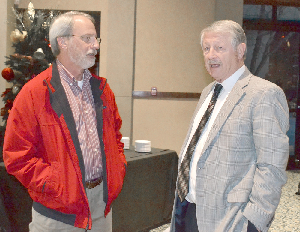 JOE WILSON, right, retiring 911 director, spoke to John Stuermer at a reception honoring Wilson for his 25 years with the system. Stuermer is executive director with the Hamilton County Emergency Communications District.