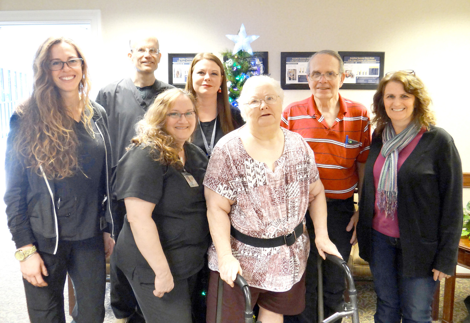 Brittney Furgerson, speech therapist; Rocco Sarli, physical therapist; Kelly Newbould, physical therapist assistant; Aundrea Davis, occupational therapist assistant; Norma Sue Betty; her husband, Bob; and her daughter, Cindy Boler, pose for a photo at Life Care Center of Cleveland.