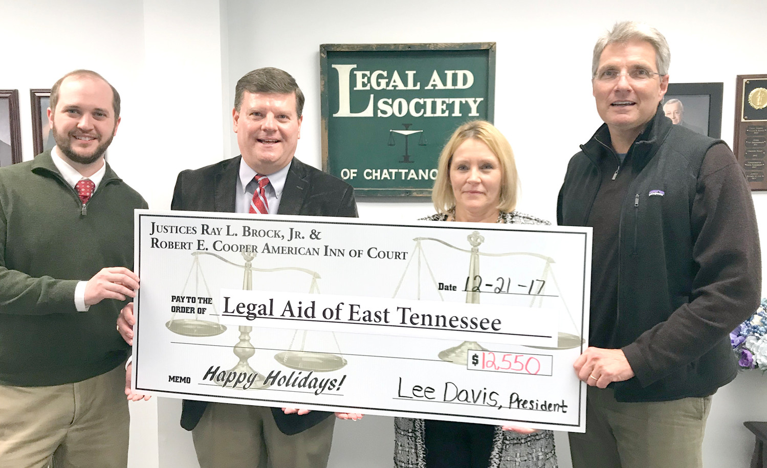 PARTICIPATING IN A recent check presentation were, from left, Charlie McDaniel, director of Operations for Legal Aid of Tennessee; Inn of Court Executive Committee member and Past President Ron Powers; Legal Aid Executive Director Sheri Fox; and Inn of Court President Lee Davis.