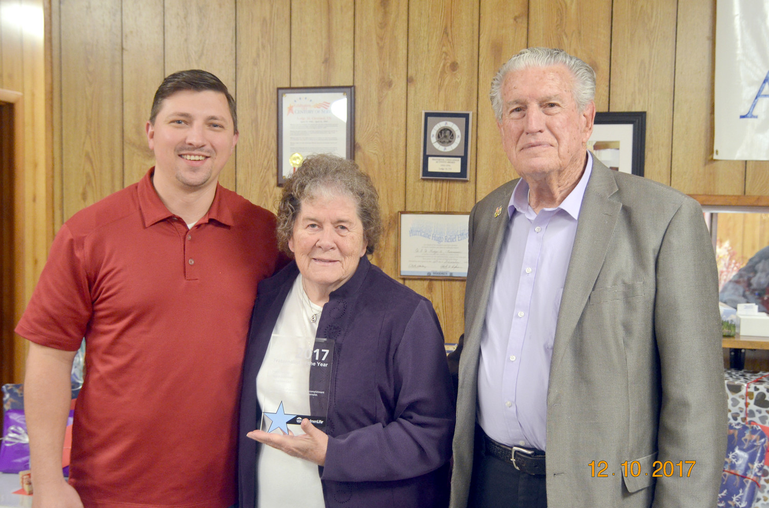 Joyce Johnson was recognized as 2017 Fraternalist of Year for East Tennessee, of the Woodmen Life. She was recognized for volunteer service, accomplishment and dedication as an outstanding fraternalist.  From left are Adam Lowe, regional director; Joyce Johnson; and WW Johnson, president of Chapter 16.
