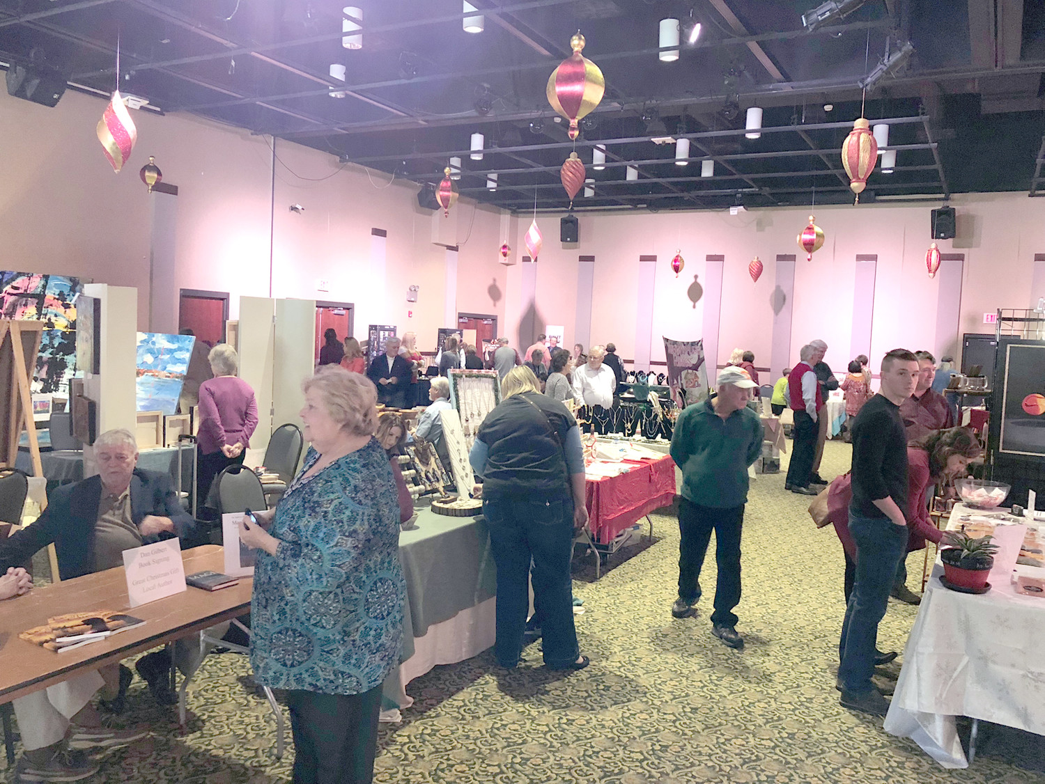 Attendants lined the halls at the Museum Center at Five Points's Christmas Open House, featuring nearly 30 local artists of varying trades.