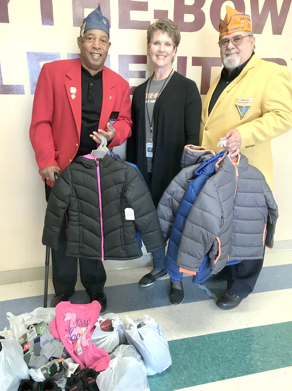 THE 40&8 SOCIETY recently donated coats and shoes to students at Blythe-Bower Elementary School. Pictured are 40&8 representatives Oscar Kelley and Rick Williams, along with Linda Tyler, family engagement coordinator at Blythe-Bower.