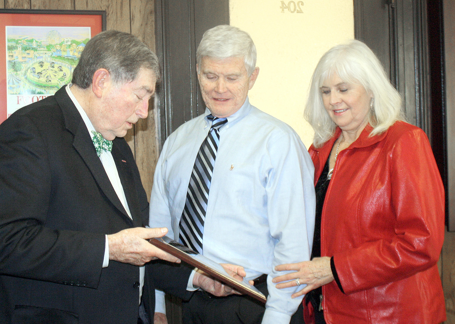 BRADLEY COUNTY DIRECTOR of the Bradley County Veterans Affairs Office Larry McDaris, left, presents a plaque of appreciation to associate Joe Davis, who has retired after more than 10 years of assisting local veterans. Looking on is Davis' wife, Judy.