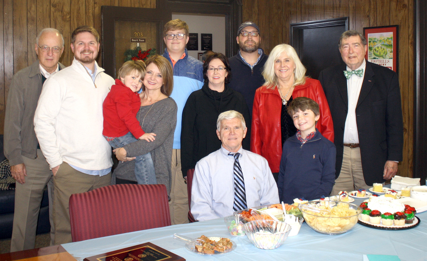 BRADLEY COUNTY Veterans Affairs Officer Joe Davis, seated, was honored with a reception Friday to mark his retirement after 10 years of serving area veterans. Attending the event were, standing from left, Sid Heidel, chairman of the Southeast Tennessee Veterans Home Council; Davis' son, Brad; grandson, Jack; daughter-in-law, Candi; grandson, Nick Nicodemus; daughter, T.J. Nicodemus; son-in-law, Pete Nicodemus; Davis' wife, Judy; grandson, Zane; and the director of the Veterans Affairs Office, Larry McDaris.