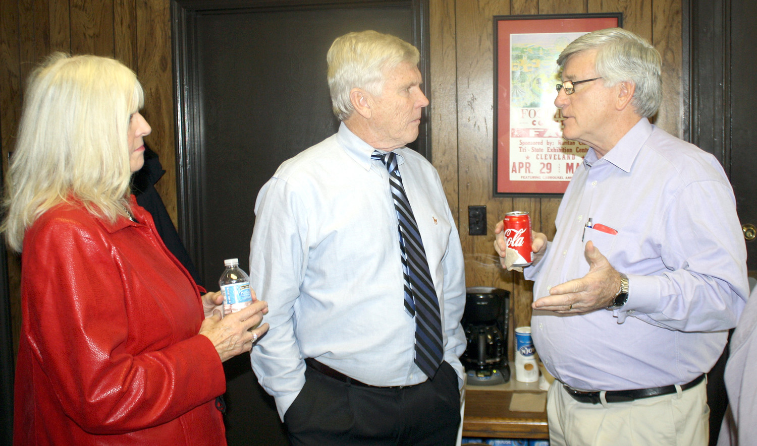 RETIRING VETERANS Affairs Officer Joe Davis, center, joins his wife, Judy, as they talk with Tennessee Sen. Todd Gardenhire, right, at Friday afternoon's reception for Davis.