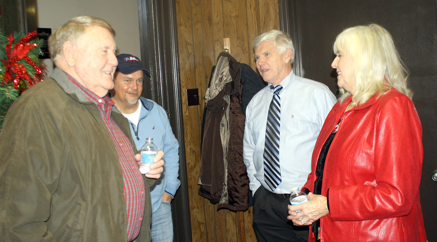 HONOREE JOE DAVIS, second from right, and his wife, Judy, talk with Bradley County Commission Chairman Louie Alford, left, and Keith Dilbeck, second from left, at Friday's retirement reception.