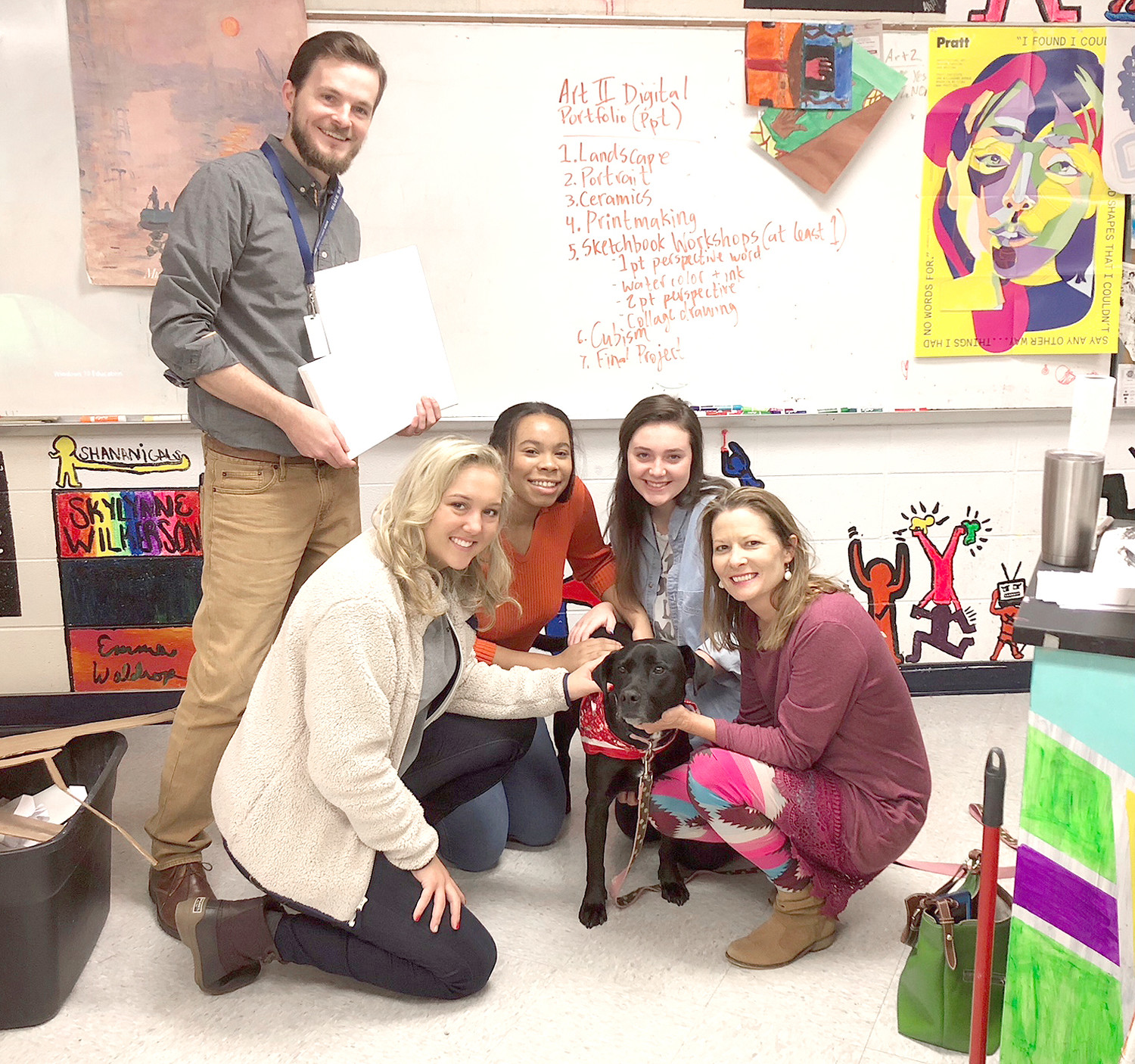 CLEVELAND HIGH students in Colin Campbell's art class helped Addie paint canvases that will be sold, with 100 percent of the proceeds from the sales going to Helping Paws Healing Hearts. From left are students Madison Rue, Tatyanna Dyer, and Makayla Hoffman, and Amy Hicks, while CHS art teacher Colin Campbell looks on.