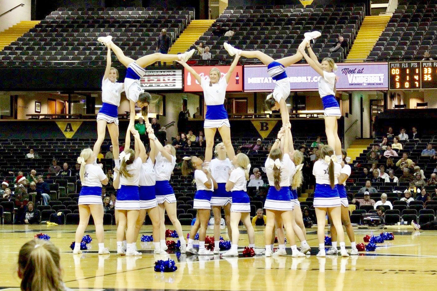 VARSITY CHEERLEADERS from Cleveland High School perform during a recent basketball game at Vanderbilt University. The squad got to help fill in for the Commodore's squad during Christmas break.