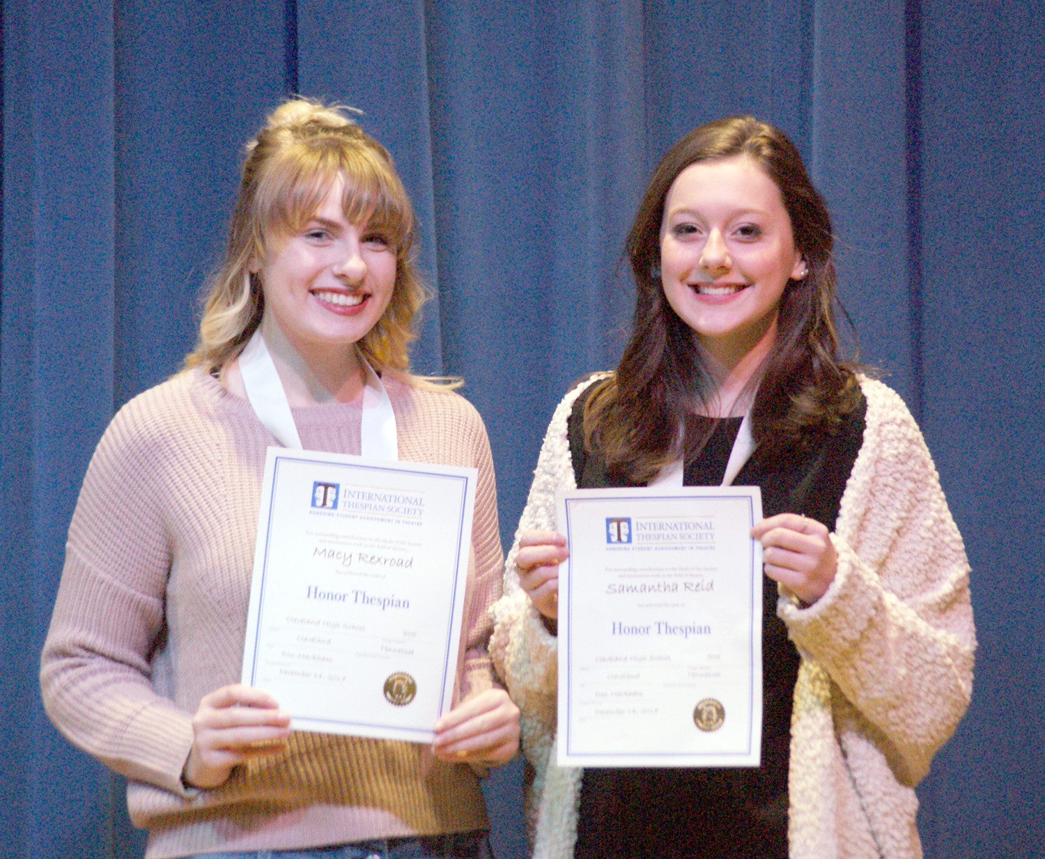 STUDENTS Macy Rexroad and Samantha Reid earned Honor Thespian Status by completing 600 hours in theater work. They were honored during Cleveland High School International Thespian Troupe 505's recent induction ceremony. The troupe is under the direction of Don Markham, with current officers Lindsay Markham, president, Macy Rexroad, vice president, and Renee McCollum, secretary.