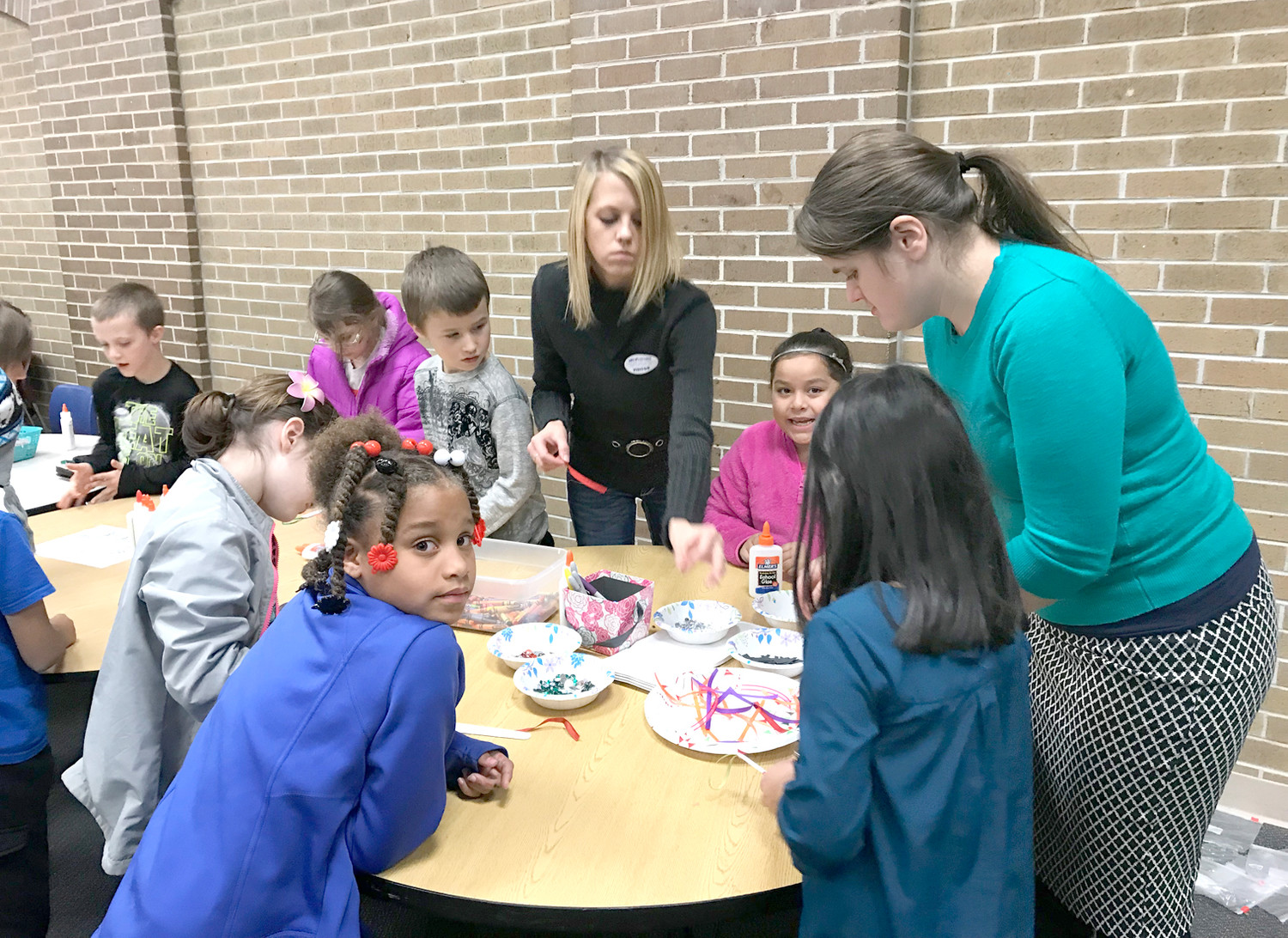 CREATIVE students at Blythe-Bower Elementary School make their own holiday ornaments during a recent event.