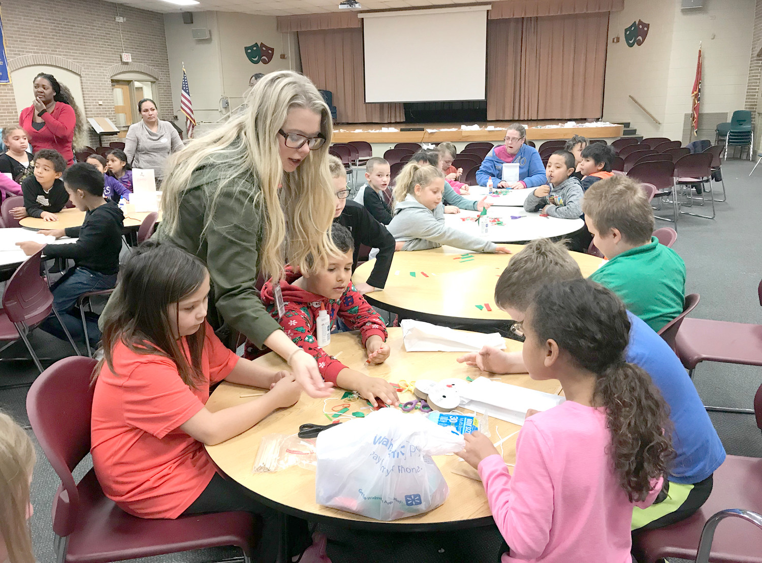 COLLABORATING on designs, students at Blythe-Bower Elementary School make ornaments during a holiday event.
