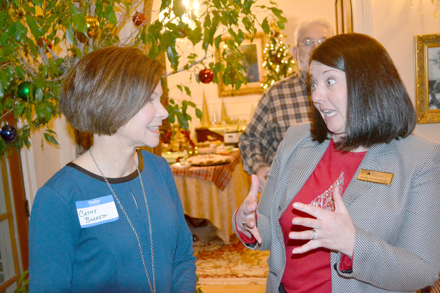 JENNIFER PENNELL-ASLINGER, right, was named the new president of Junior Achievement of the Ocoee Region in 2018. Here, she talks with Cathy Barrett, executive director of the Cleveland Community Foundation during a reception held in the new president's honor. Barrett once served as the JA president several years ago.