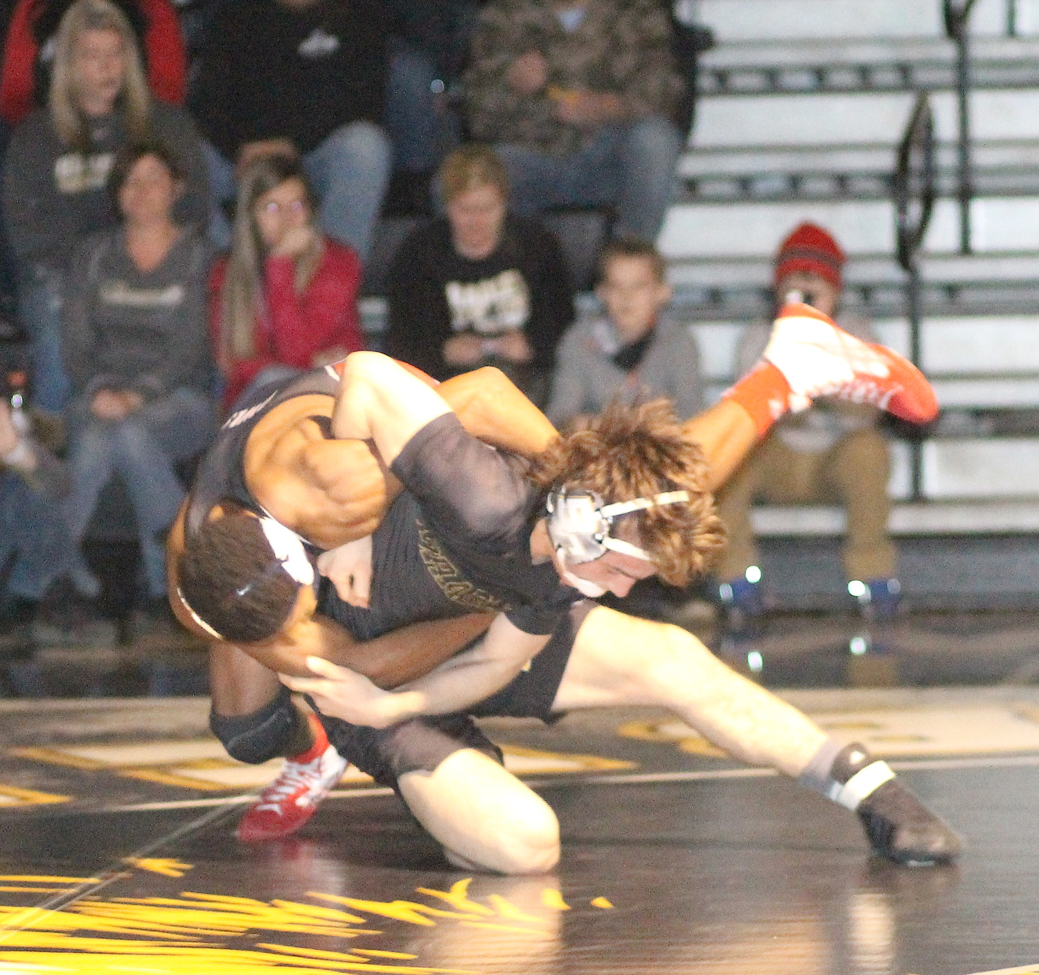 BRADLEY CENTRAL senior Andy Robinson, right, hip tosses Ooltewah's Mykkel Banks to the mat during Tuesday evening's District 8-AAA action at Jim Smiddy Arena. The fifth-ranked 145-pounder led the Bears to a 58-15 win.