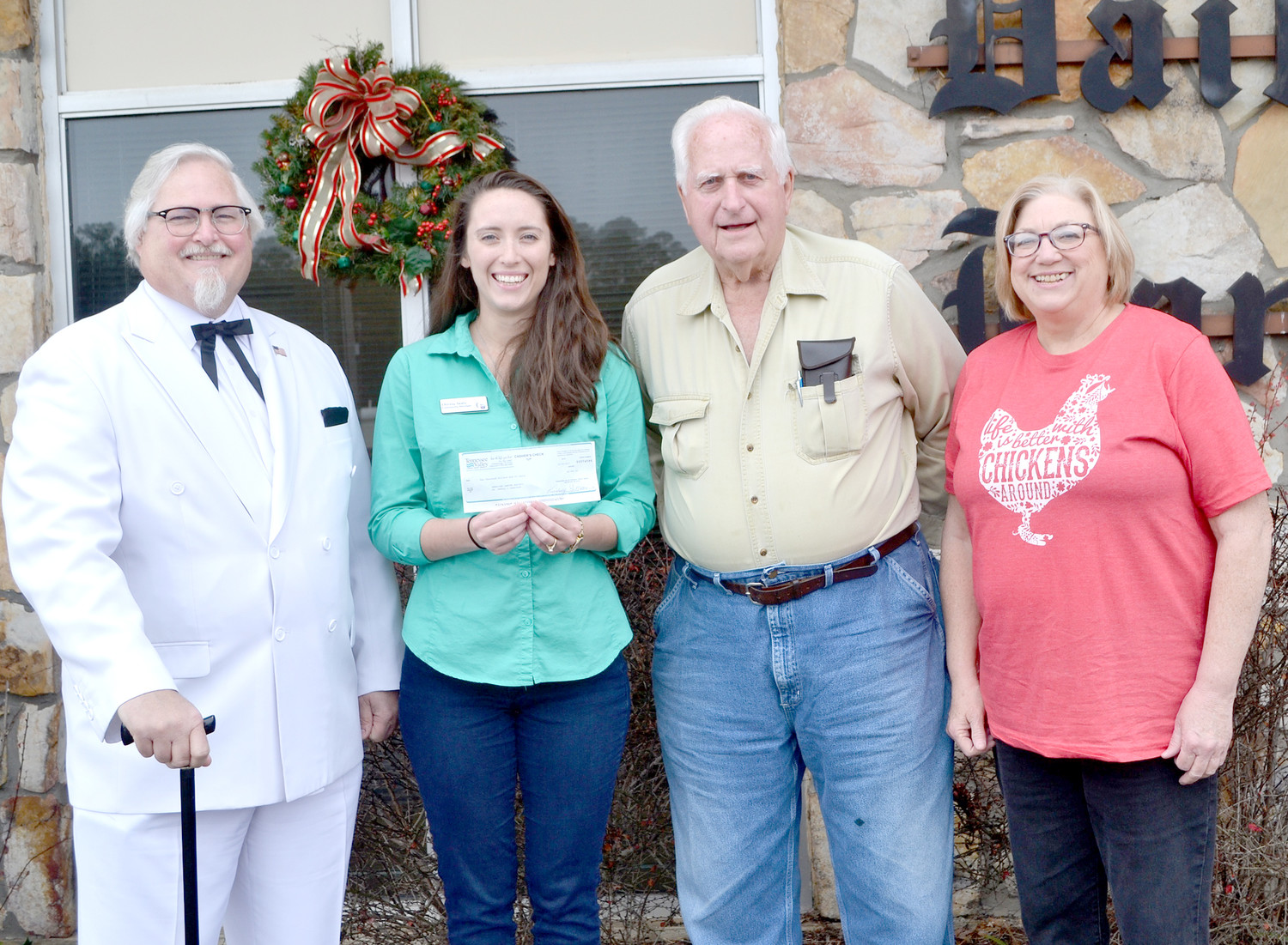 THE BUCKET COLONEL recently presented a $2,000 check to Chrissy Seals of Bradley County Relay for Life. The donation comes from the sale of a tractor the colonel won at the Prater's Mill festival. From left are the Bucket Colonel (Randall Garrison), Seals, Jim Seitz, who purchased the tractor, and Joyce Garrison.