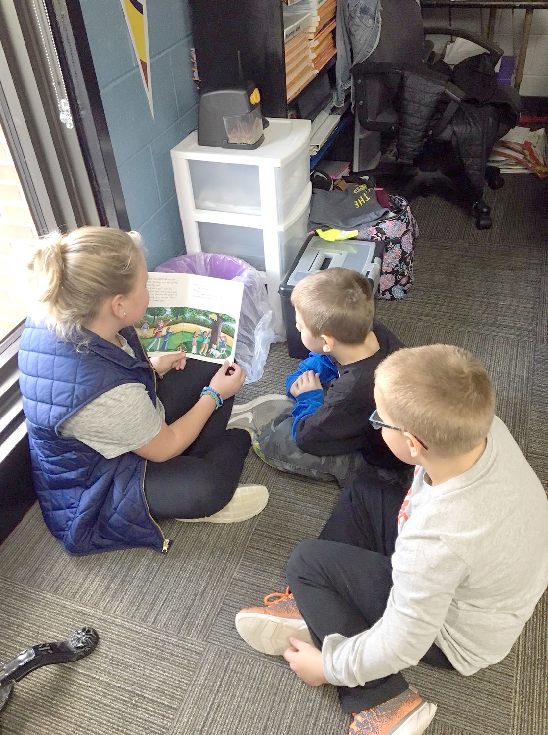 Emily Harvey reads to Hunter Harvey and Jeremiah Buckner;