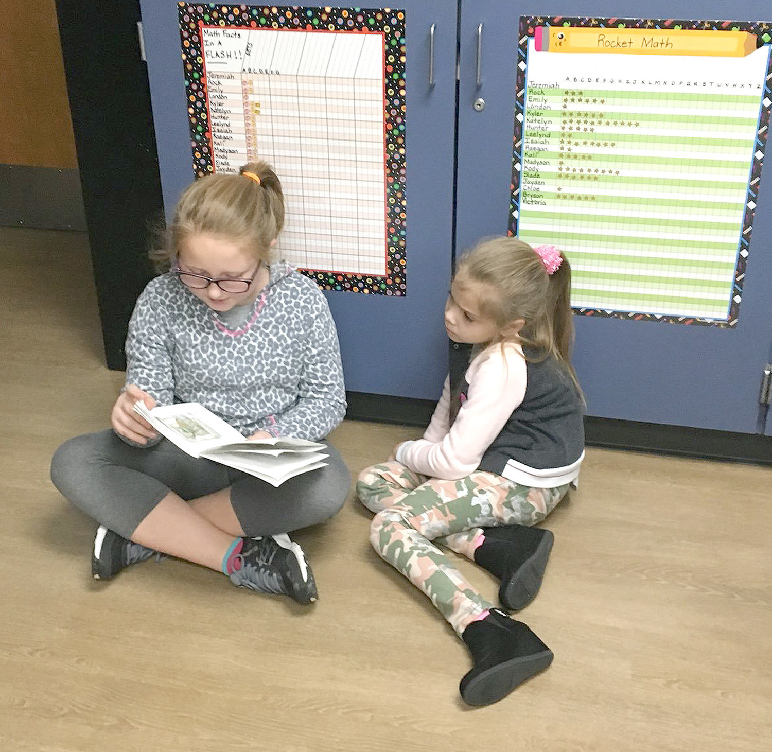 Kambria Charles reads a story to Madyson Ledford.