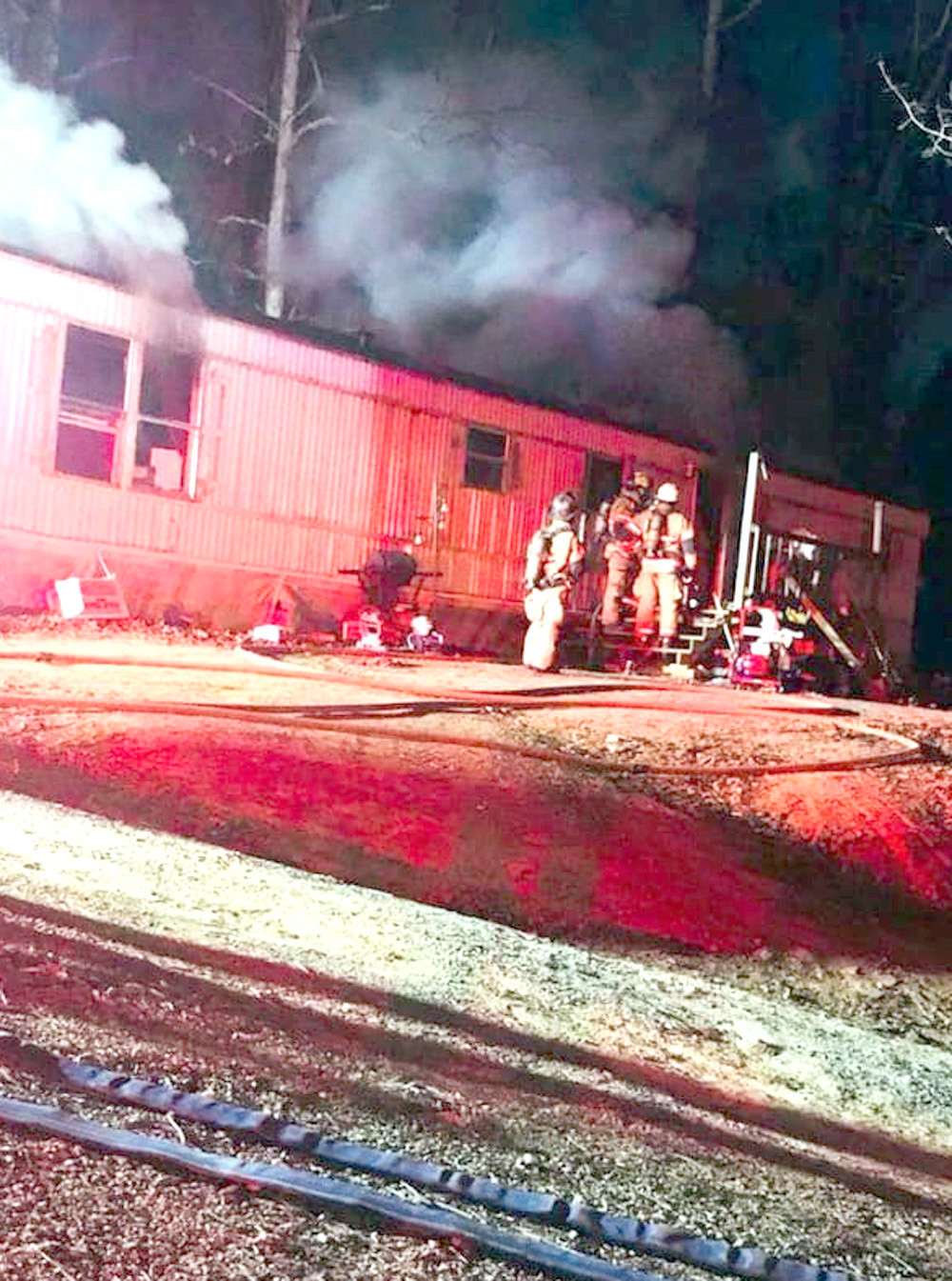 FIREFIGHTERS WORK at a fire at 182 Van Davis Road early Thursday. According to BCFR Chief Shawn Fairbanks, the fire started in the hallway and appeared to be electrical in nature. Fairbanks said that early investigation found that the house was a total loss from the fire.