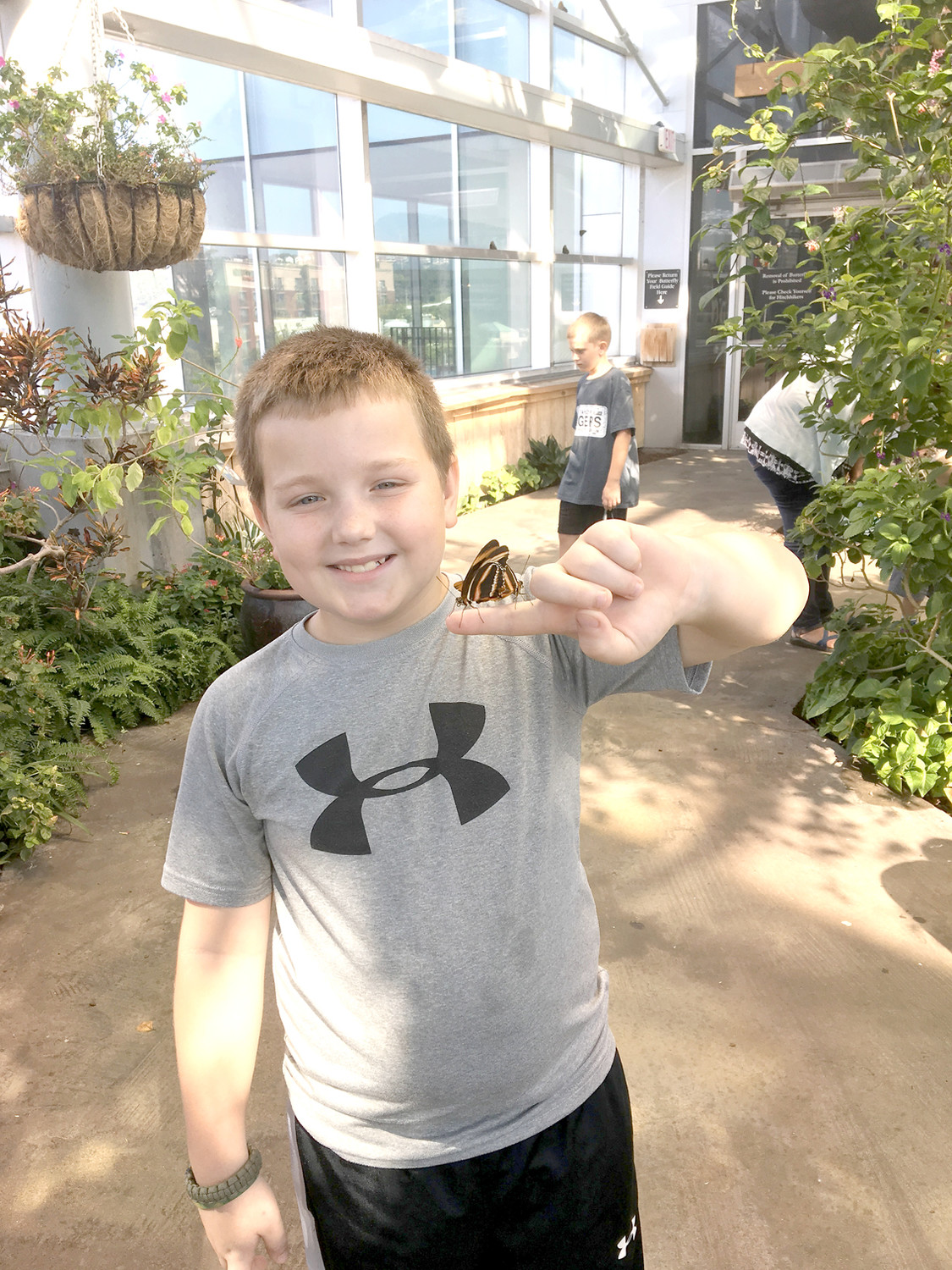 TATEN HILL from Miss Smith's fourth-grade class at Taylor Elementary shows off the new butterfly friend he met while on a field trip to the Tennessee Aquarium.