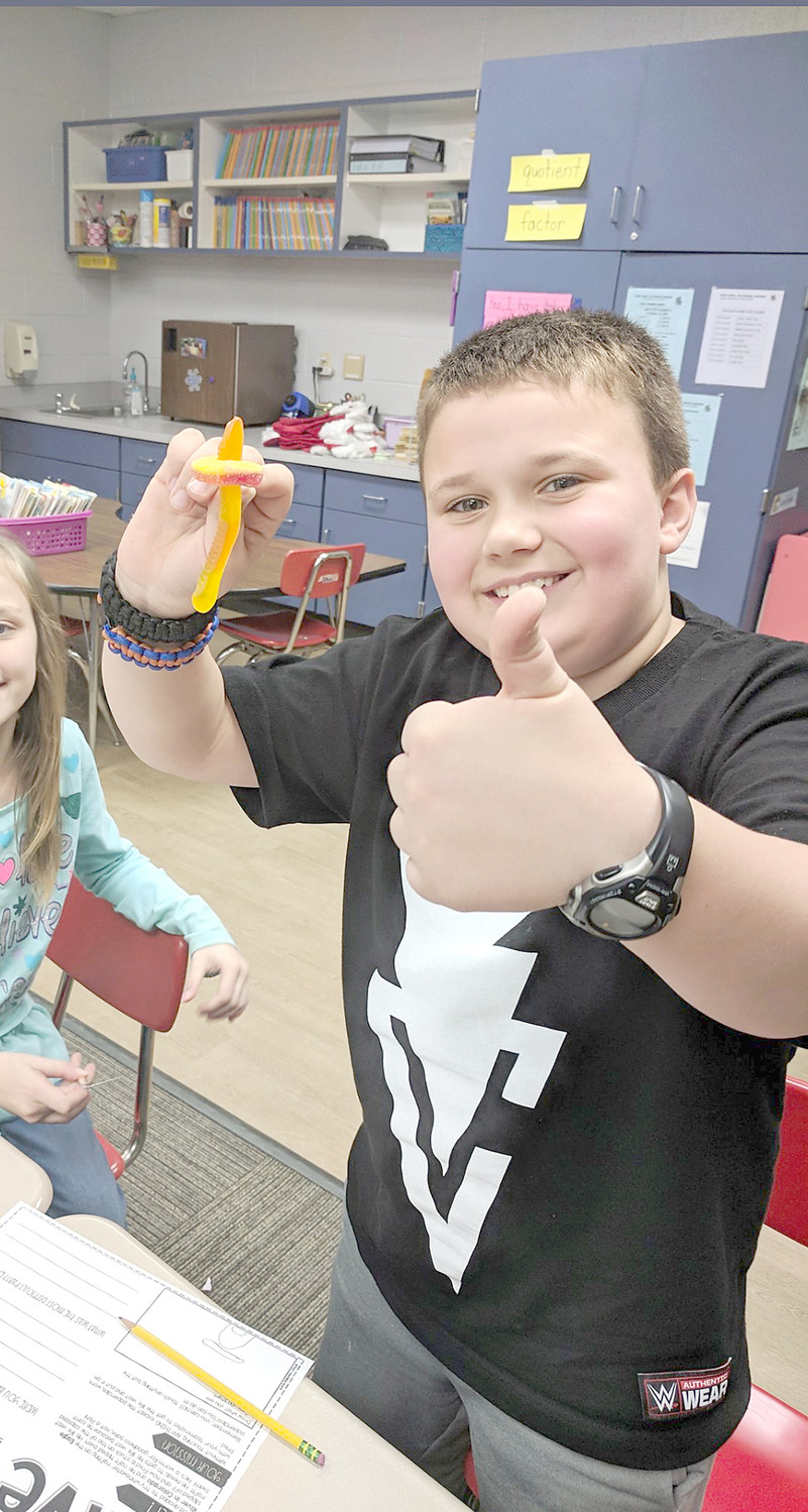 "NOAH RUSSELL was able to successfully ""save Fred"" while participating in a STEM-related activity in Mrs. Cole's third-grade class at Taylor Elementary School. He had to use his problem-solving skills to rescue the gummy worm with only a paper clip."
