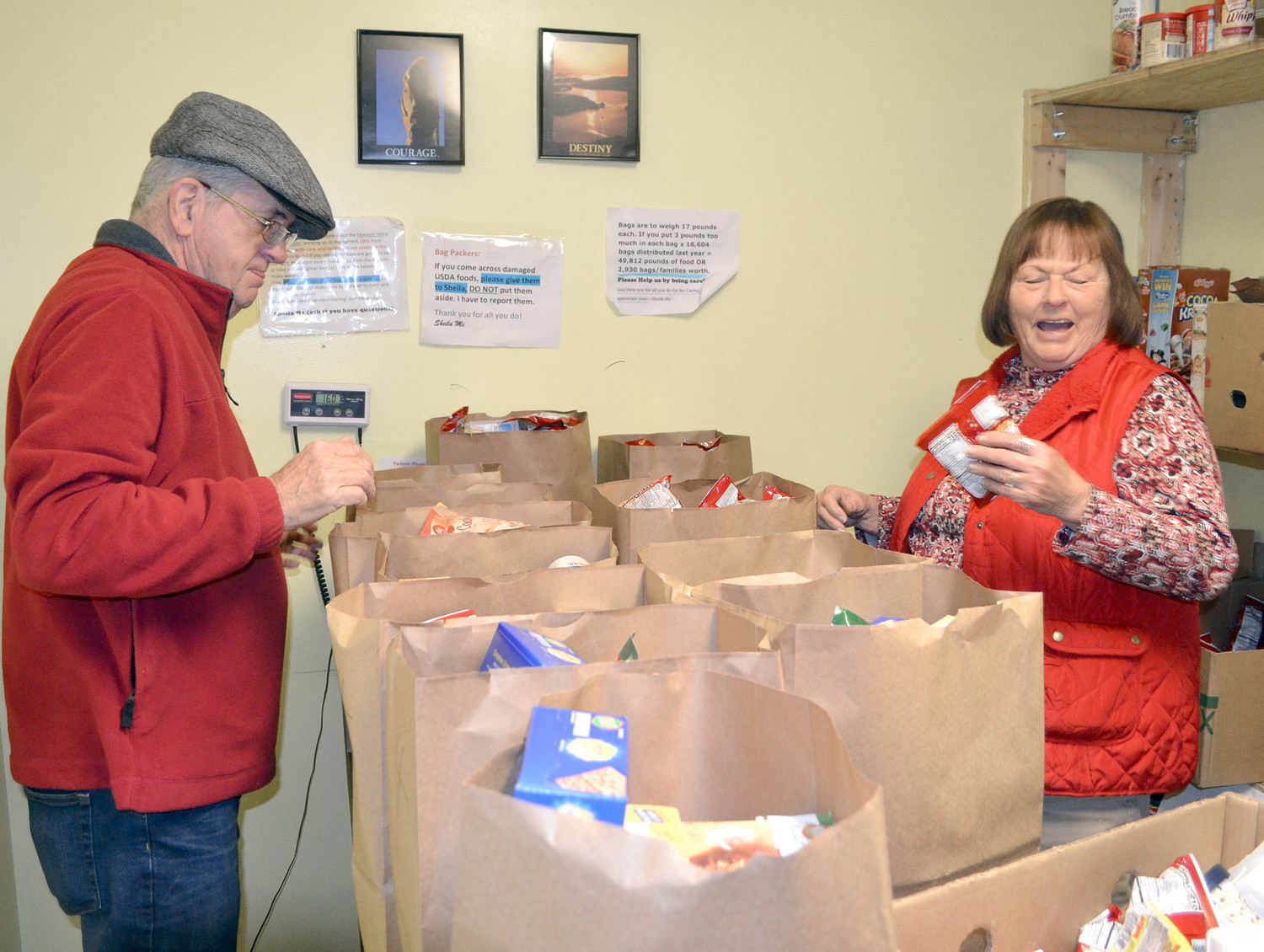 HUSBAND AND WIFE Ralph and Virginia Murray work at bagging food at The Caring Place.