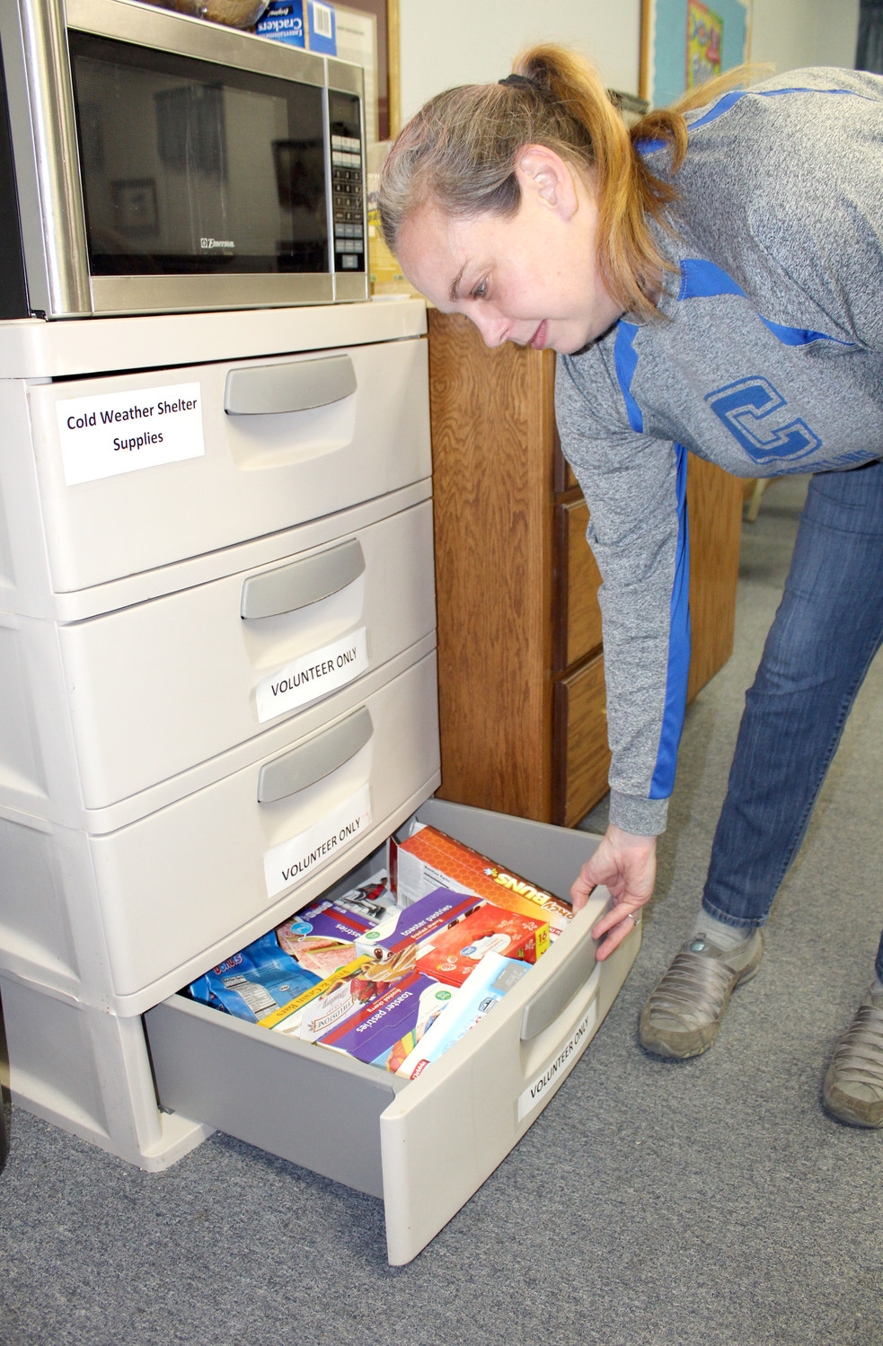 STOCKING supplies for Wesley Memorial United Methodist Church's Cold Weather Shelter is part of coordinator Amy Mott's responsibilities. The shelter, which opens when temperatures are 30 degrees or lower, is currently slated to operate now through Thursday.