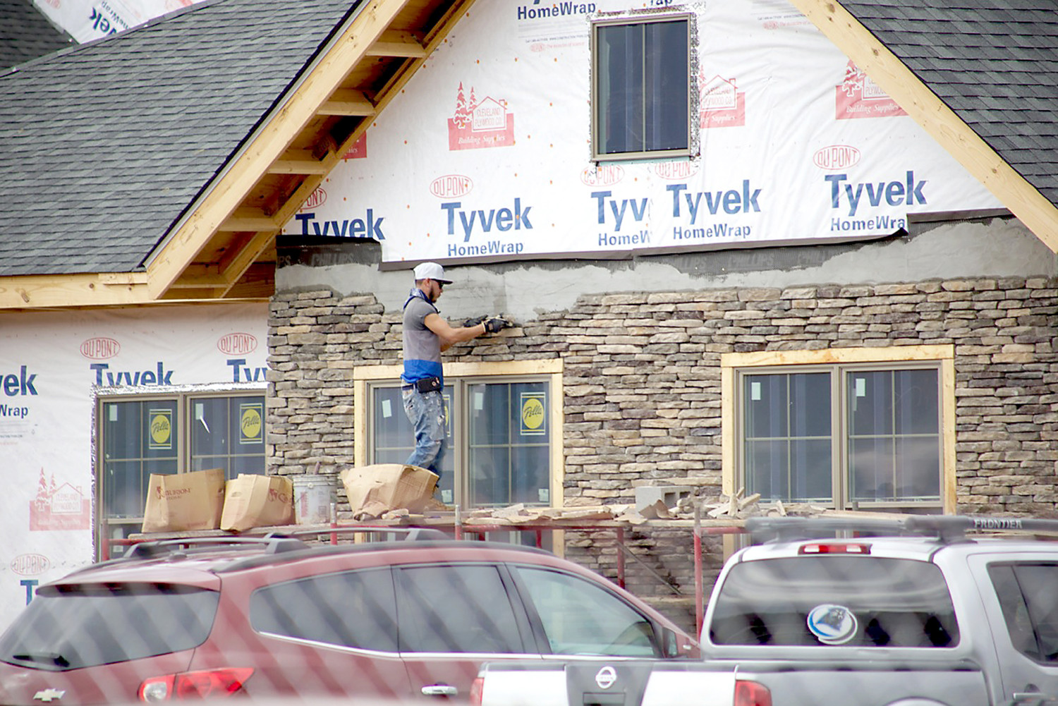 CONSTRUCTION OF THE new Legacy Village treatment and care facility on Candies Lane is progressing. A workman for Tri-Con Construction is shown placing stone on the side of one of the apartment units.