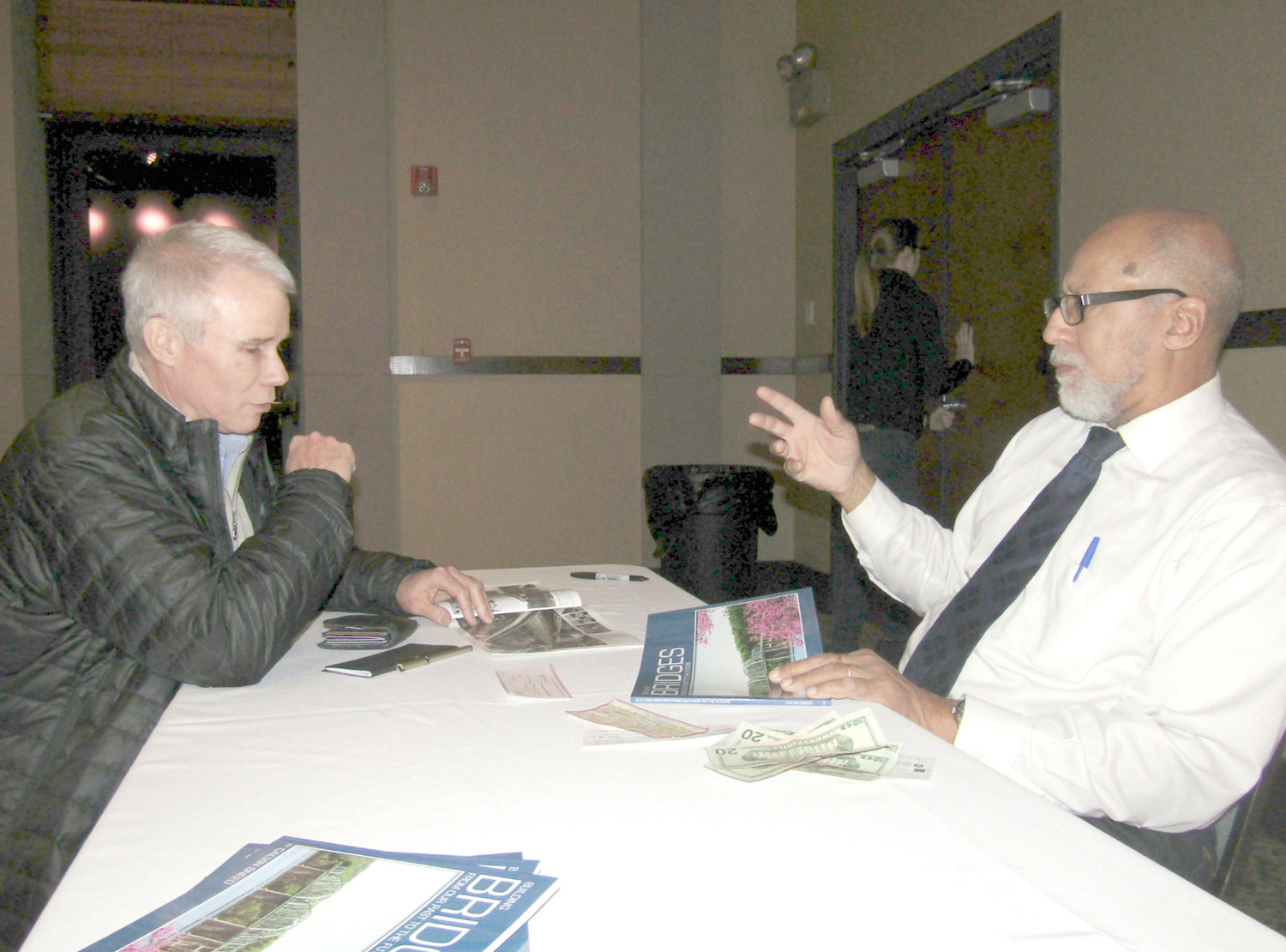 Greenway Board Chairman Cameron Fischer, left, talks with veteran newsman Calvin Sneed about the efforts to restore the Dobbs Ford Bridge.